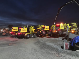 fleet of cement mixers and concrete trucks